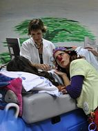 Medical clown Shoshi Ofir working with the medical staff and a young patient at the Tene Center. (photo credit: ISRAEL21c)