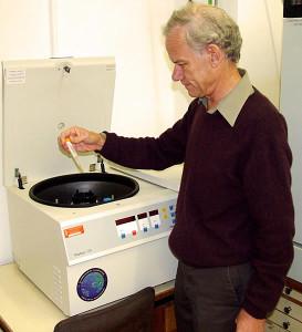 Professor Amos Panet nearby the centrifuge machine