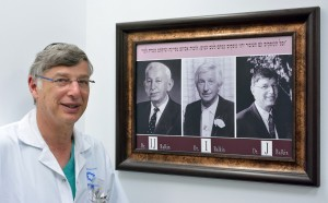 Dr. Balkin beside a picture of himself, his father, and grandfather - three generations of physicians (CC IsraCast) (Photo: Tomer Yaffe)