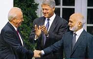 Yitzhak Rabin and King Hussein signing the Israel-Jordan Peace Treaty (1994)