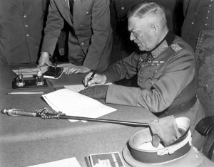Field Marshall Wilhelm Keitel signing the unconditional surrender of the German Wehrmacht at the Soviet headquarters in Karlshorst, Berlin.