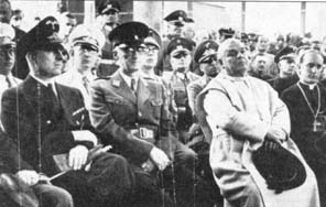 The papal nuncio Marcone (in the white robes of the Dominican order), Archbishop Stepinac next to him, and around them sit leading military representatives of Nazi Germany and the NDH